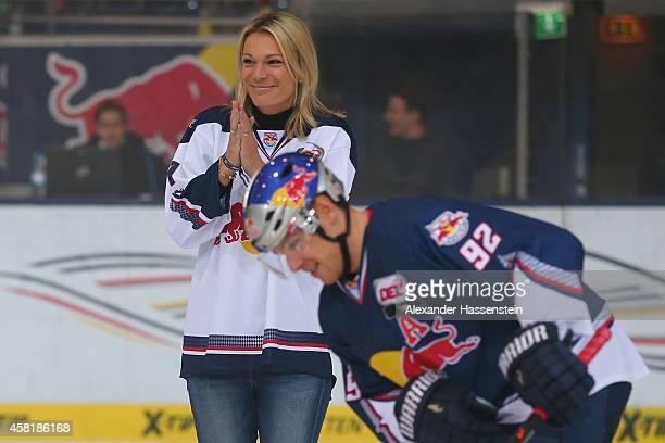Maria HoeflRiesch opens the first bully next to Alexander Barta of Muenchen for the DEL Ice Hockey match between EHC Red Bull Muenchen and Krefeld...