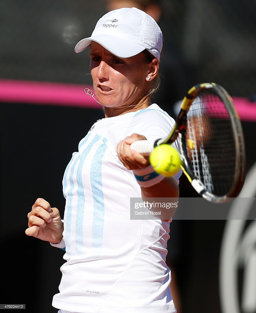 Maria Irigoyen of Argentina takes a forehand shot during a round 2 match between Maria Irigoyen of Argentina and Lara Arruabarrena of Spain as part of World Group II Playoffs of Fed Cup 2015 between Argentina and Spain at Tecnopolis on April 18, 2015 in Villa Martelli, Buenos Aires, Argentina. The playoff will decide who gets to maintain their position in the group.