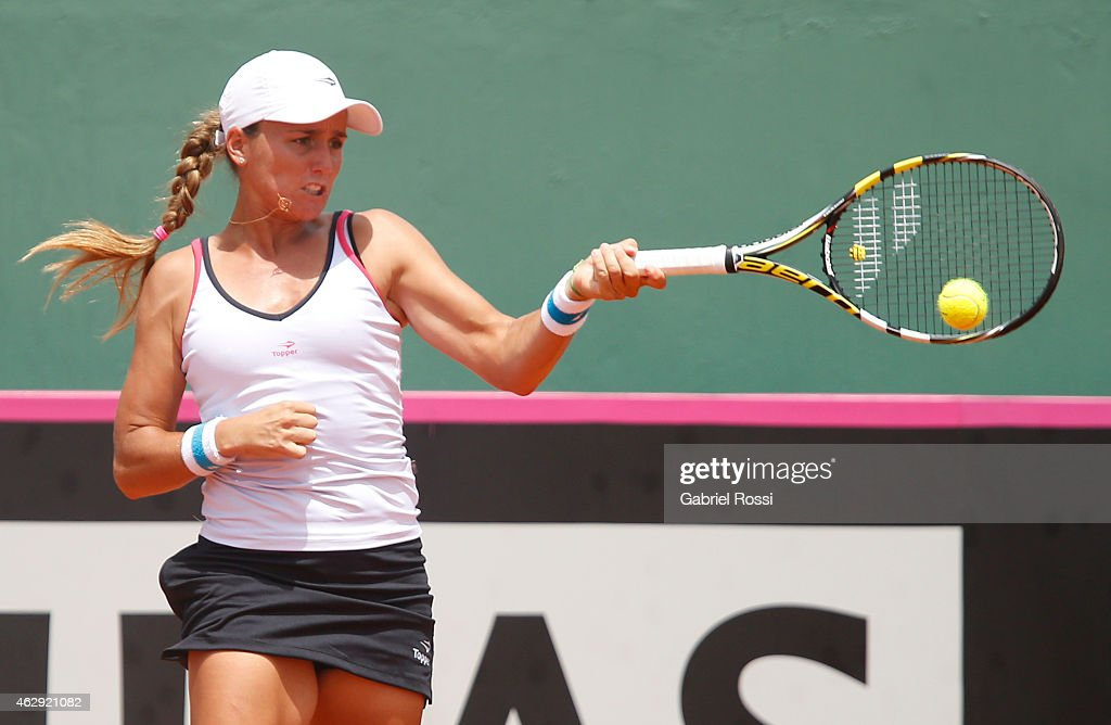 Maria Irigoyen of Argentina takes a shot during her single match against Serena Williams of USA as part of Fed Cup 2015 at Pilara Tenis Club on February 07, 2015 in Buenos Aires, Argentina.