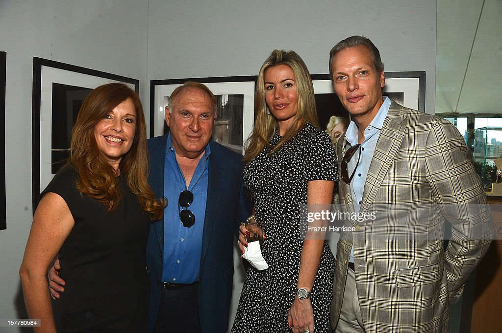 Maria Isabel Carril, Mauricio Zeilic, Carmen Raquel Bernal and President and CEO at Chopard U.S. Marc Hruschka attend the Chopard and W Magazine 'Marilyn Forever' exhibition at Soho Beach House on December 6, 2012 during Art Basel Miami in Miami Beach, Florida.