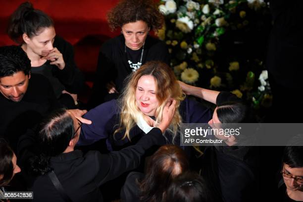 Maria Jose daugther of Mexican painter and sculptor Jose Luis Cuevas takes part in a ceremony in his honor at the Fine Arts Palace in Mexico City on...