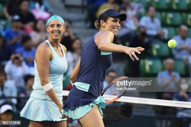Maria Jose Martinez Sanchez of Spain celebrates winning with doubles partner Andreja Klepac of Slovenia after defeating Daria Gavrilova of Australia...