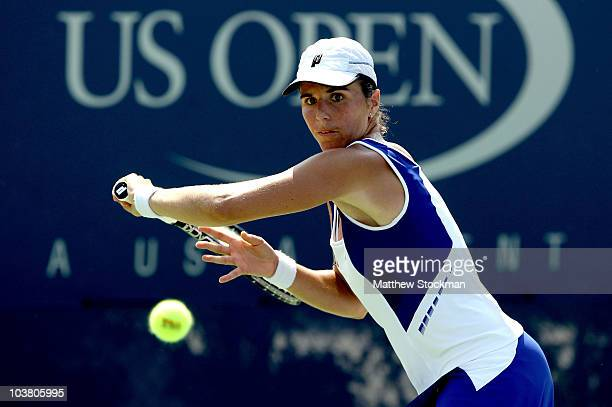 Maria Jose Martinez Sanchez of Spain hits a shot to Patty Schnyder of Switzerland during the Women's singles on day four of the 2010 US Open at the...