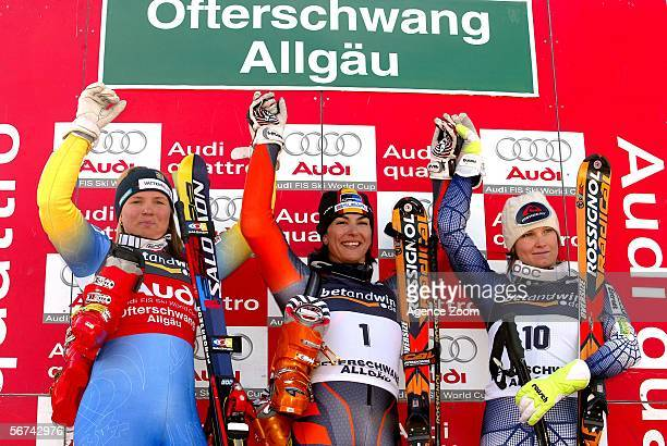 Maria Jose Rienda of Spain and Anja Paerson of Sweden and Julia Mancuso of USA celebrate during the FIS Skiing World Cup Women's Giant Slalom on...