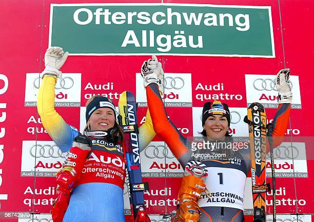 Maria Jose Rienda of Spain and Anja Paerson of Sweden celebrate during the FIS Skiing World Cup Women's Giant Slalom on February 4 2006 in...