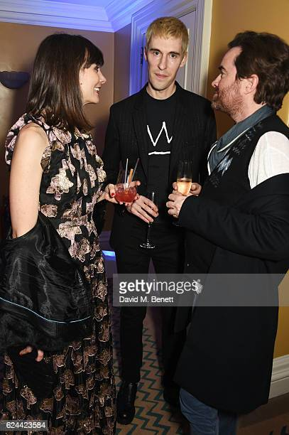 Maria Kastani Clym Evernden and Nick Haddow attend Claridge's Christmas Tree 2016 Party with tree designed by Sir Jony Ive and Marc Newson at...