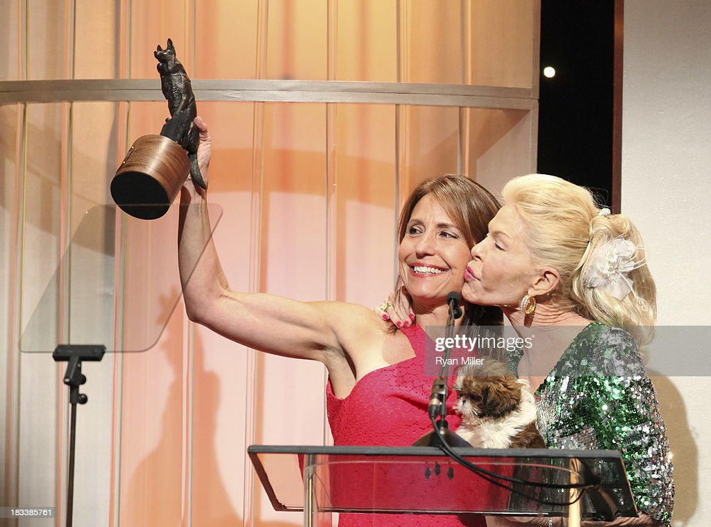 Maria Kessel (L) and Lois Pope (R) accept their award during the American Humane Association Hero Dog Awards 2013 held at the Beverly Hilton Hotel on Saturday, Oct. 5, 2013, in Beverly Hills, California.