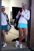Maria Kirilenko Nadia Petrova of Russia prepare to walk out before their match against Andrea Hlavackova Lucie Hradecka of Czech Republic in the...