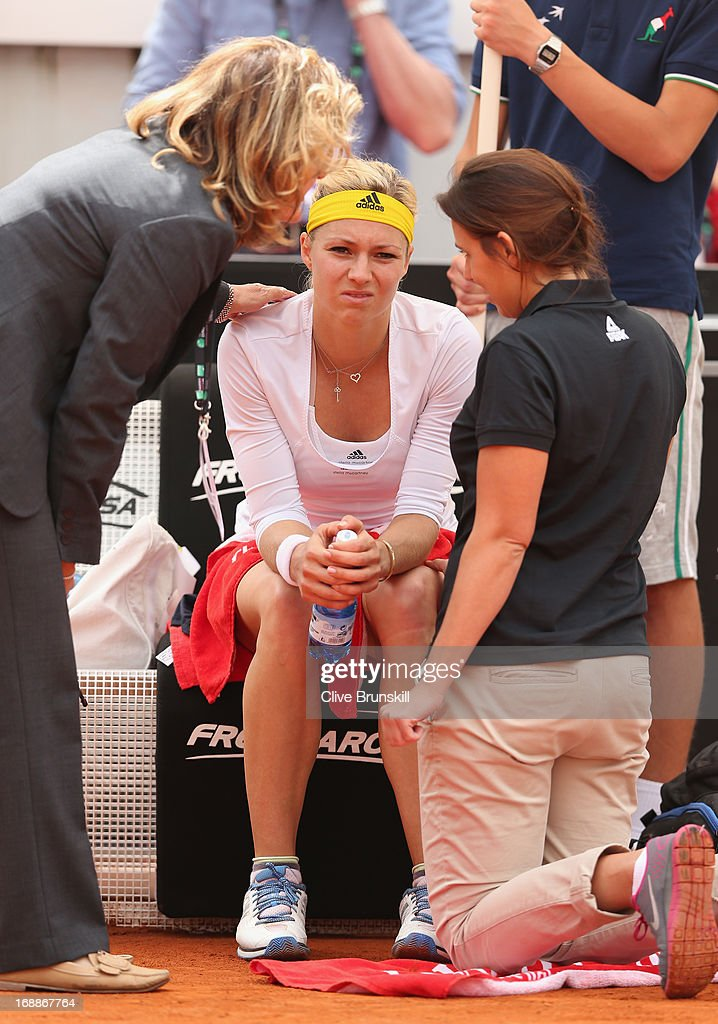 Maria Kirilenko of Russia about to retire due to an injury against Sara Errani of Italy in their third round match during day five of the Internazionali BNL d'Italia 2013 at the Foro Italico Tennis Centre on May 16, 2013 in Rome, Italy.