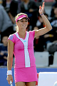 Maria Kirilenko of Russia acknowledges the crowd after her win over Julia Goerges of Germany during the China Open at the National Tennis Center on...