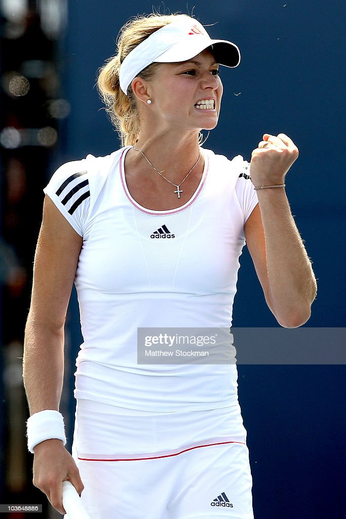 <a gi-track='captionPersonalityLinkClicked' href=/galleries/search?phrase=Maria+Kirilenko&family=editorial&specificpeople=211512 ng-click='$event.stopPropagation()'>Maria Kirilenko</a> of Russia celebrates a point against Dinara Safina of Russia during the Pilot Pen tennis tournament at the Connecticut Tennis Center on August 26, 2010 in New Haven, Connecticut.