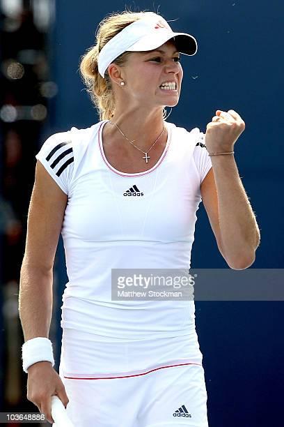 Maria Kirilenko of Russia celebrates a point against Dinara Safina of Russia during the Pilot Pen tennis tournament at the Connecticut Tennis Center...