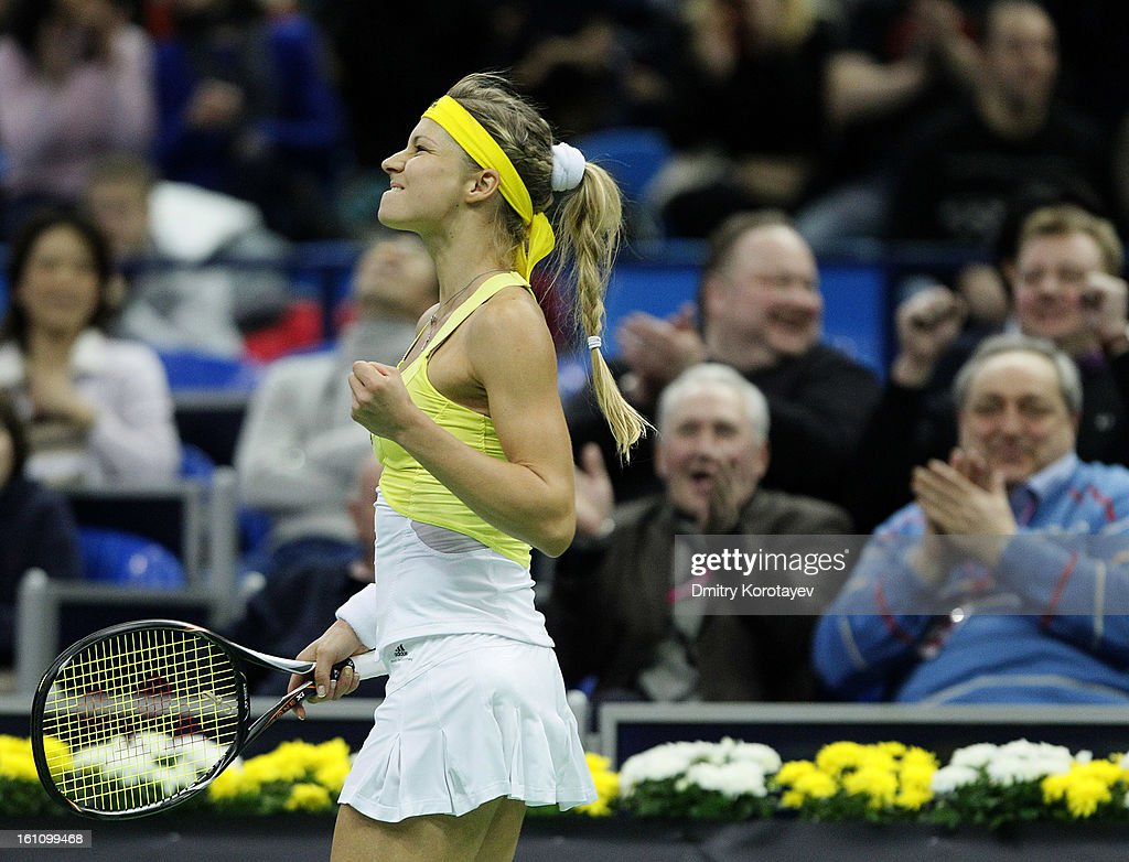 <a gi-track='captionPersonalityLinkClicked' href=/galleries/search?phrase=Maria+Kirilenko&family=editorial&specificpeople=211512 ng-click='$event.stopPropagation()'>Maria Kirilenko</a> of Russia celebrates a point against Kimiko Date-Krumm of Japan during day one of the Federation Cup 2013 World Group Quarterfinal match between Russia and Japan at Olympic Stadium on February 09, 2013 in Moscow, Russia.
