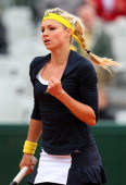 Maria Kirilenko of Russia celebrates a point during her Women's Singles match against Ashleigh Barty of Australia on day six of the French Open at...