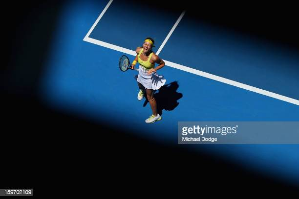 Maria Kirilenko of Russia celebrates match point in her third round match against Yanina Wickmayer of Belarus during day six of the 2013 Australian...