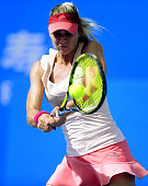 Maria Kirilenko of Russia competes with Pironkova Tsvetana of Bulgaria during day 3 of 2014 China Open on September 29 2014 in Beijing China