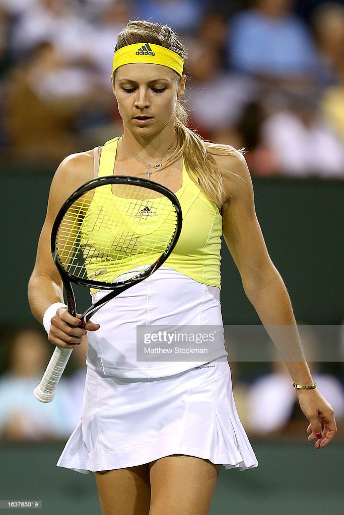 Maria Kirilenko of Russia examines her racquet between points while playing Maria Sharapova of Russia during the BNP Paribas Open at the Indian Wells Tennis Garden on March 15, 2013 in Indian Wells, California.