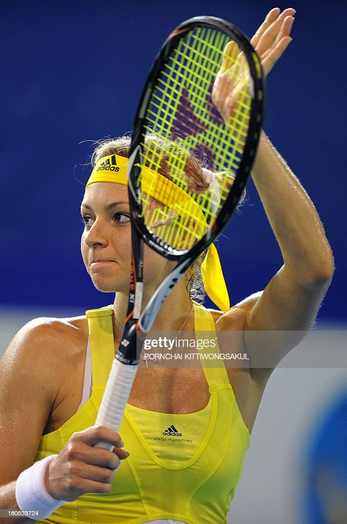 Maria Kirilenko of Russia gestures to her fans after defeating Sorana Cirstea of Romania during the tennis women's singles semi-final round of the WTA Pattaya Open tennis tournament in Pattaya resort on February 2, 2013.