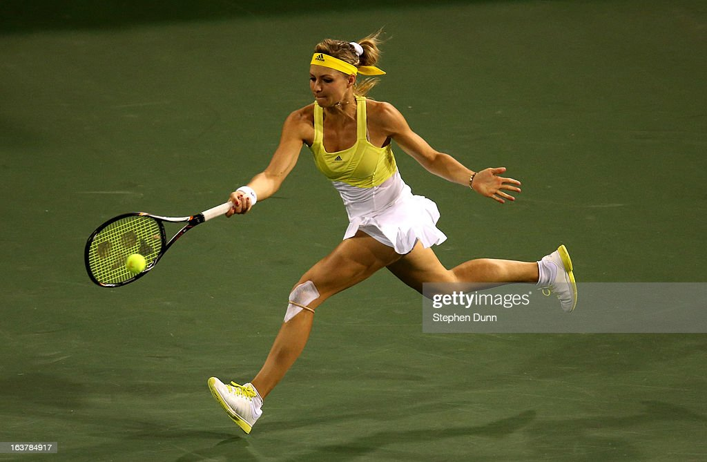 Maria Kirilenko of Russia hits a return to Maria Sharapova of Russia in their semifinal match during day 10 of the BNP Paribas Open at Indian Wells Tennis Garden on March 15, 2013 in Indian Wells, California.