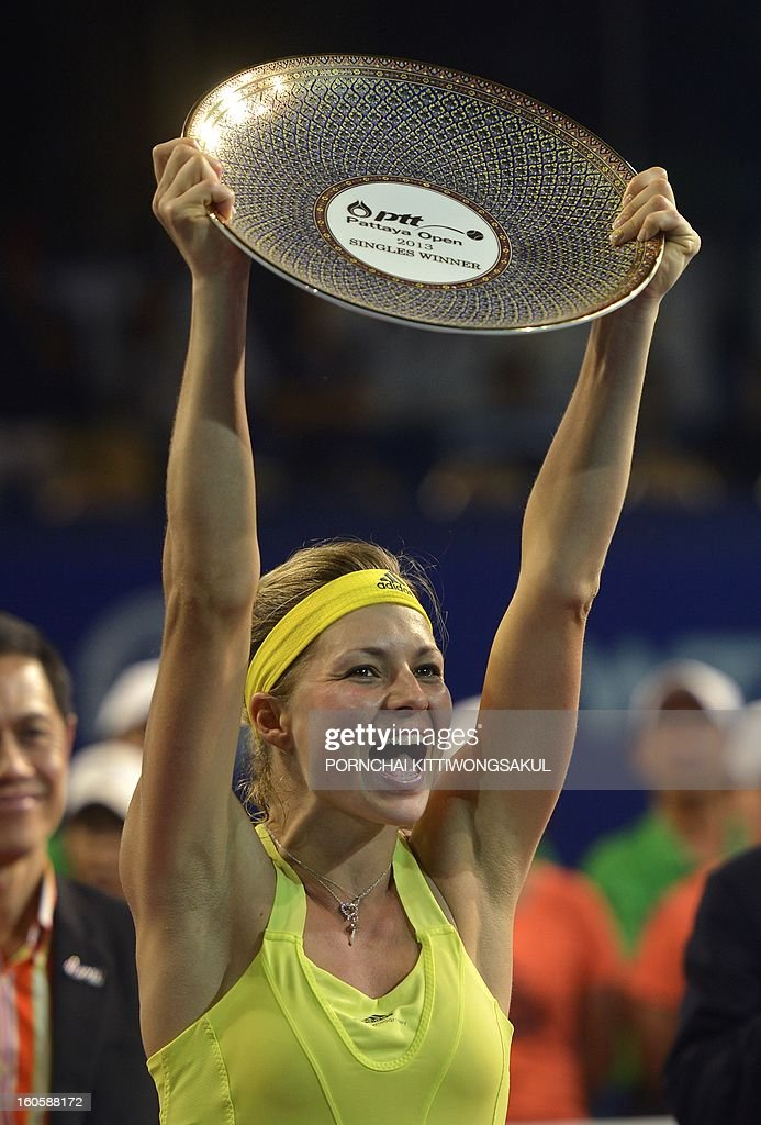 Maria Kirilenko of Russia holds the winner's trophy after defeating Sabine Lisicki of Germany in the final of the WTA Pattaya Open tennis tournament in Pattaya resort on February 3, 2013. Kirilenko beat Lisicki 7-5, 1-6, 6-7.