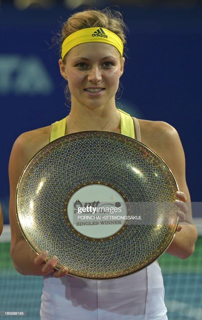 Maria Kirilenko of Russia holds the winner's trophy after defeating Sabine Lisicki of Germany in the final round of the WTA Pattaya Open tennis tournament in Pattaya resort on February 3, 2013. Kirilenko beat Lisicki 7-5, 1-6, 6-7. AFP PHOTO/PORNCHAI KITTIWONGSAKUL
