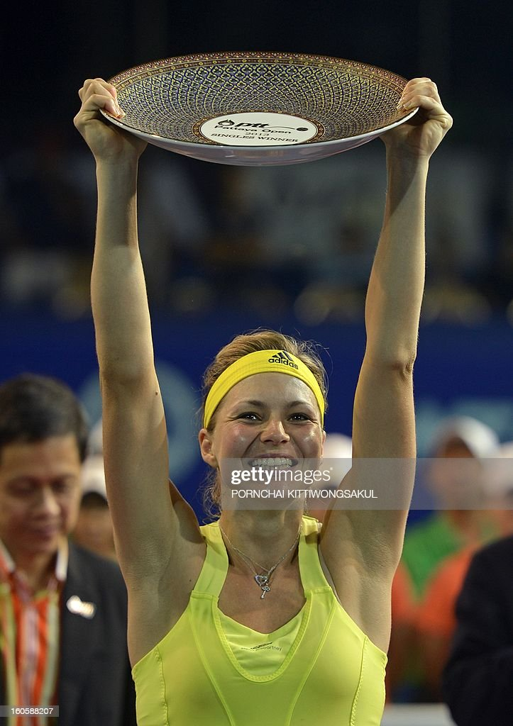 Maria Kirilenko of Russia holds the winner's trophy after defeating Sabine Lisicki of Germany in the final round of the WTA Pattaya Open tennis tournament in Pattaya resort on February 3, 2013. Kirilenko beat Lisicki 7-5, 1-6, 6-7.