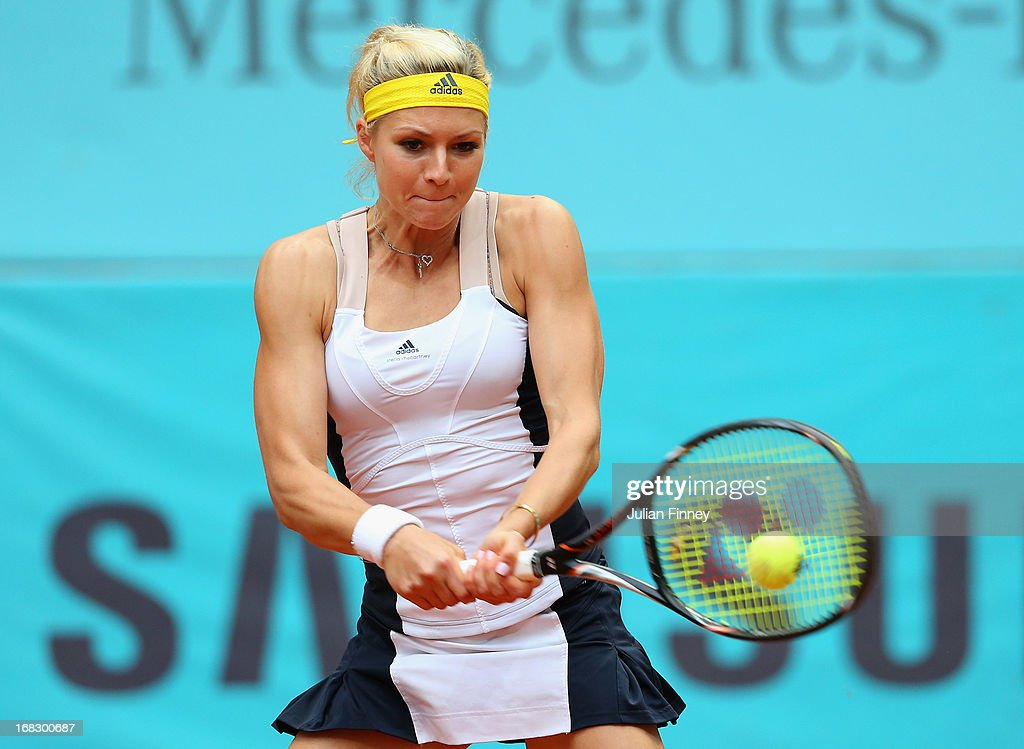 Maria Kirilenko of Russia in action against Kristina Mladenovic of France during day five of the Mutua Madrid Open tennis tournament at the Caja Magica on May 8, 2013 in Madrid, Spain.