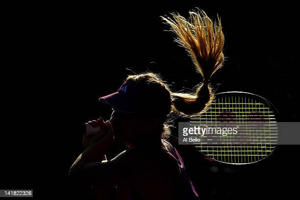 Maria Kirilenko of Russia playing with doubles partner Nadia Petrova of Russia returns a shot against Su Wei Hsieh of Chinese Taipai and Shuai Peng...