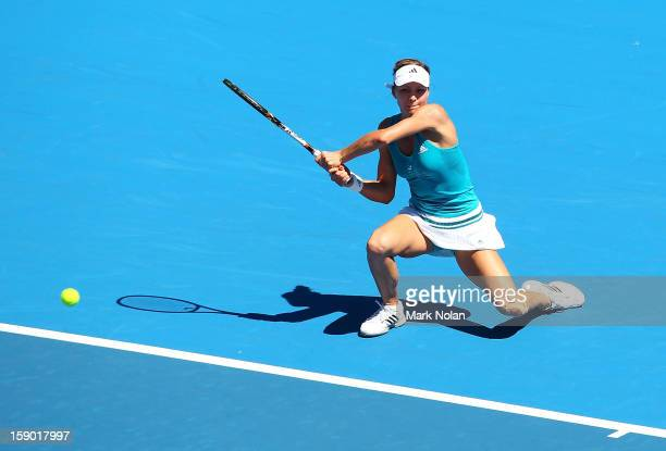 Maria Kirilenko of Russia plays a backhand in her first round match against Olivia Rogowska of Australia during day one of the Sydney International...