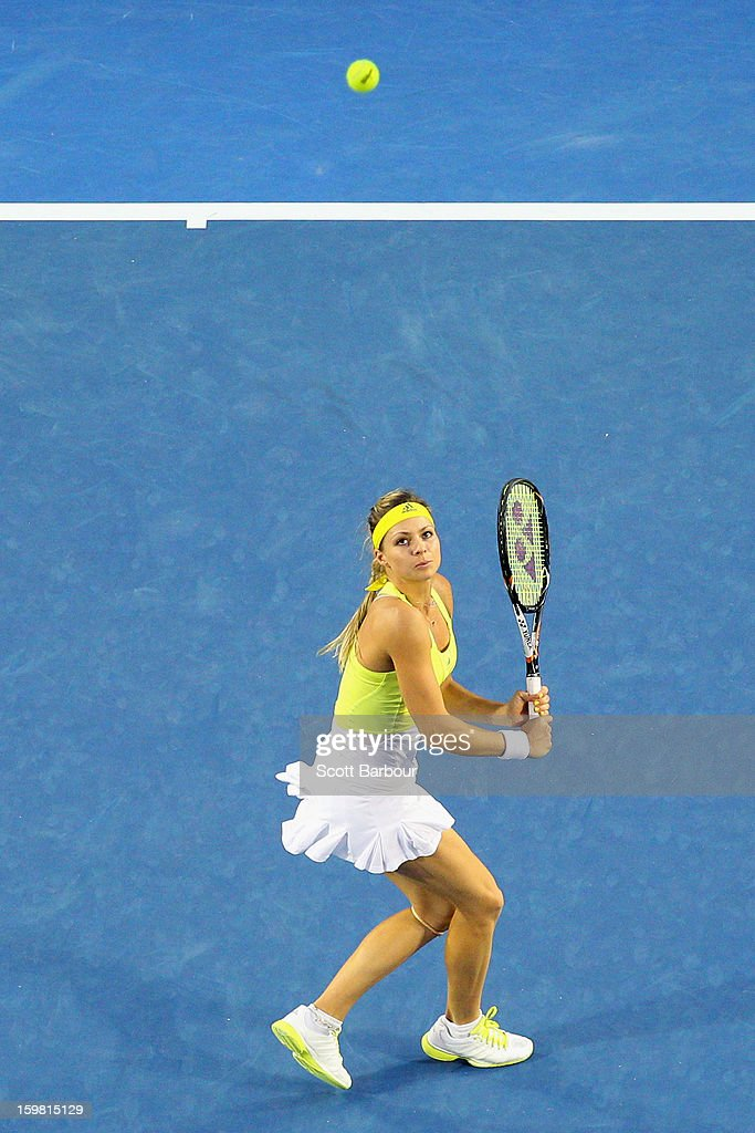 Maria Kirilenko of Russia plays a backhand in her fourth round match against Serena Williams of the United States during day eight of the 2013 Australian Open at Melbourne Park on January 21, 2013 in Melbourne, Australia.