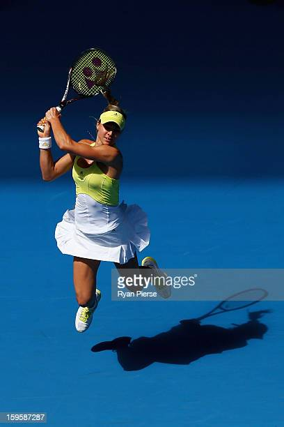Maria Kirilenko of Russia plays a backhand in her second round match against Shuai Peng of China during day four of the 2013 Australian Open at...