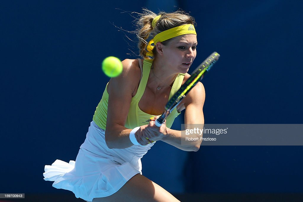 Maria Kirilenko of Russia plays a backhand in her third round match against Yanina Wickmayer of Belarus during day six of the 2013 Australian Open at Melbourne Park on January 19, 2013 in Melbourne, Australia.