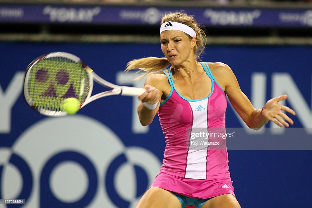 <a gi-track='captionPersonalityLinkClicked' href=/galleries/search?phrase=Maria+Kirilenko&family=editorial&specificpeople=211512 ng-click='$event.stopPropagation()'>Maria Kirilenko</a> of Russia plays a forehand in her match against Samantha Stosur of Australia during the day three of the Toray Pan Pacific Open at Ariake Colosseum on September 27, 2011 in Tokyo, Japan.