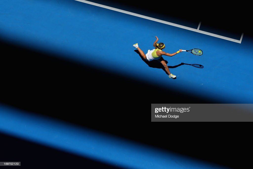<a gi-track='captionPersonalityLinkClicked' href=/galleries/search?phrase=Maria+Kirilenko&family=editorial&specificpeople=211512 ng-click='$event.stopPropagation()'>Maria Kirilenko</a> of Russia plays a forehand in her third round match against Yanina Wickmayer of Belarus during day six of the 2013 Australian Open at Melbourne Park on January 19, 2013 in Melbourne, Australia.