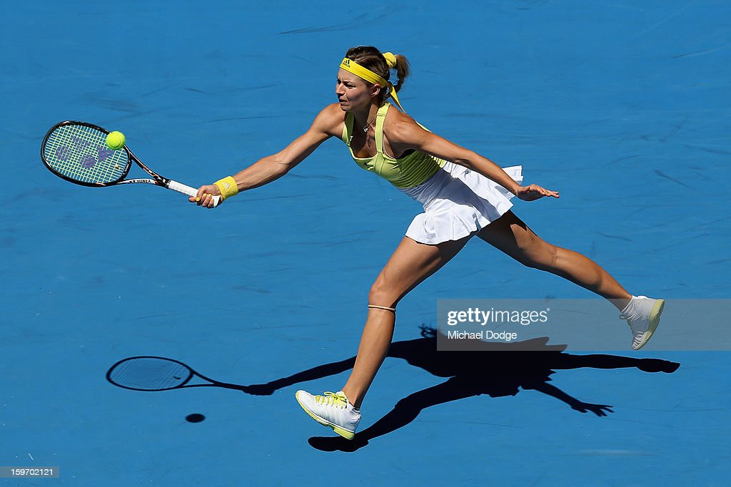 Maria Kirilenko of Russia plays a forehand in her third round match against Yanina Wickmayer of Belarus during day six of the 2013 Australian Open at Melbourne Park on January 19, 2013 in Melbourne, Australia.