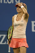 Maria Kirilenko of Russia reacts against Maria Sharapova of Russia during her women's singles first round match on Day One of the 2014 US Open at the...