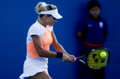 Maria Kirilenko of Russia returns a ball to Urszula Radwanska of Poland on day four of the 2013 China Open at National Tennis Center on October 1...