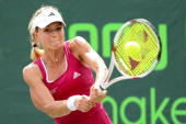 Maria Kirilenko of Russia returns a shot against Melinda Czink of Hungary during day four of the 2010 Sony Ericsson Open at Crandon Park Tennis...