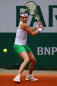 Maria Kirilenko of Russia returns a shot during her women's singles match against Johanna Larsson of Sweden on day one of the French Open at Roland...