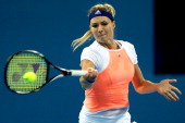 Maria Kirilenko of Russia returns a shot to Jie Zheng of China during day two of the 2013 China Open at the National Tennis Center on September 29...