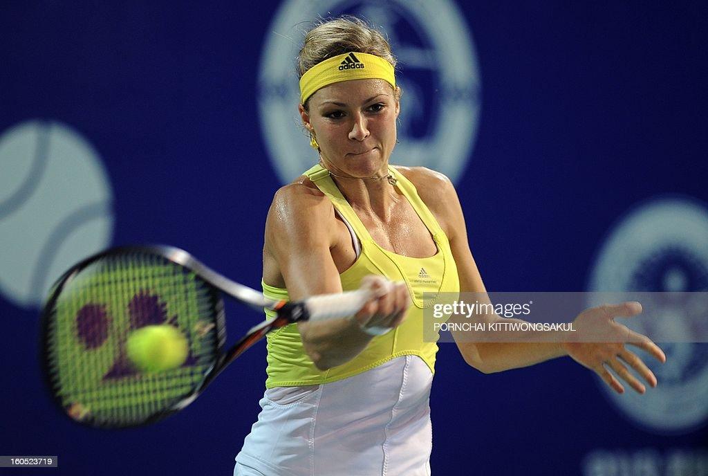 Maria Kirilenko of Russia returns a shot to Sorana Cirstea of Romania during the tennis women's singles semi-final round of the WTA Pattaya Open tennis tournament in Pattaya resort on February 2, 2013.