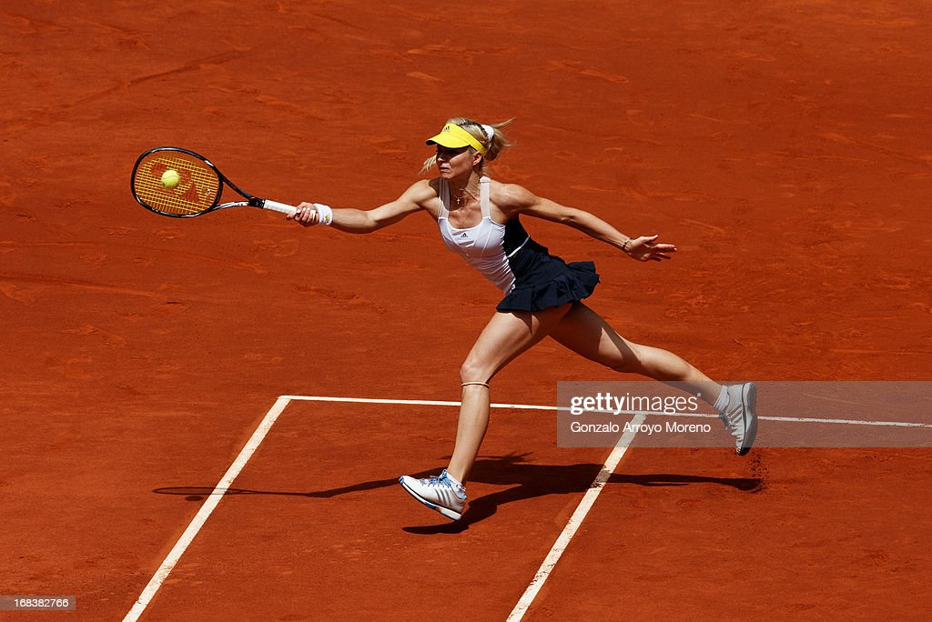 Maria Kirilenko of Russia runs to play a forehand to Serena Williams of the United States of America in her match against on day six of the Mutua Madrid Open tennis tournament at the Caja Magica on May 9, 2013 in Madrid, Spain.