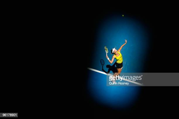 Maria Kirilenko of Russia serves in her quarterfinal match against Jie Zheng of China during day nine of the 2010 Australian Open at Melbourne Park...