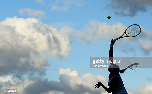 Maria Kirilenko of Russia serves the ball during her Ladies' singles third round match against Sorana Cirstea of Romania on day five of the Wimbledon...