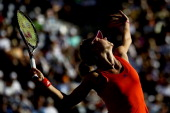 Maria Kirilenko of Russia serves to Maria Sharapova of Russia during the BNP Paribas Open at the Indian Wells Tennis Garden on March 15 2012 in...