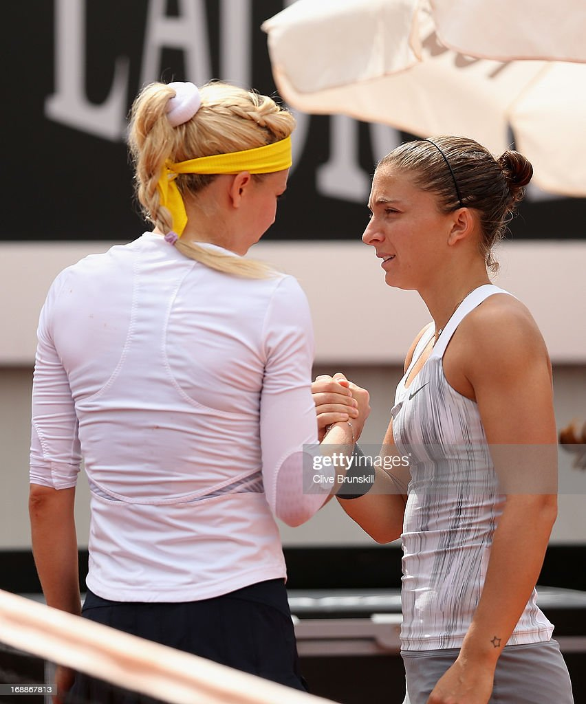 Maria Kirilenko of Russia shakes hands as she retires due to an injury against Sara Errani of Italy in their third round match during day five of the Internazionali BNL d'Italia 2013 at the Foro Italico Tennis Centre on May 16, 2013 in Rome, Italy.
