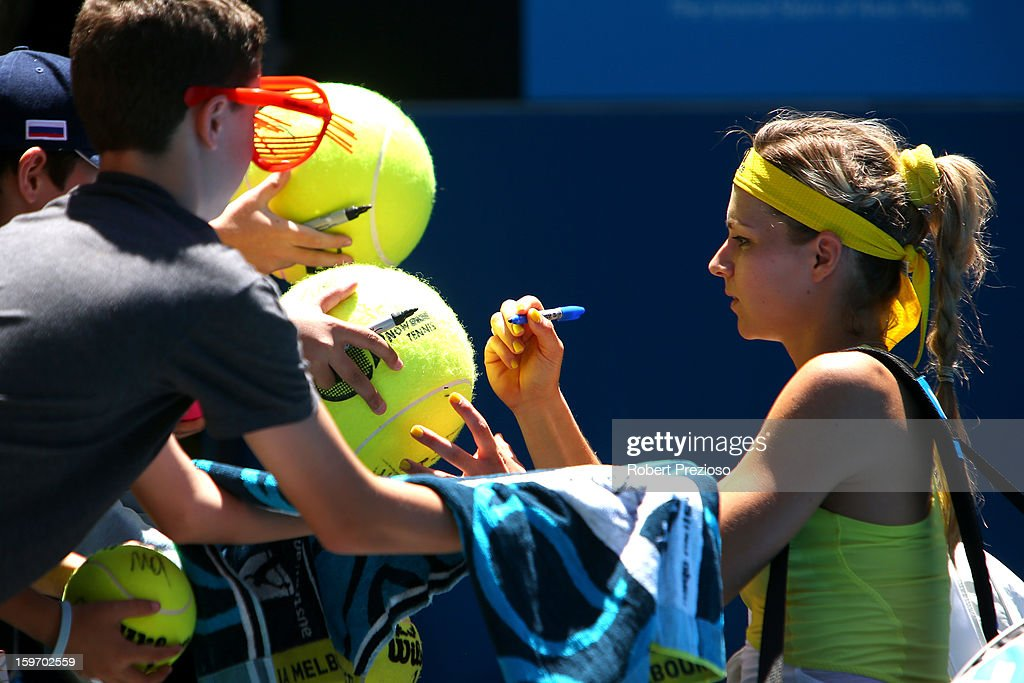 Maria Kirilenko of Russia signs an autograph after winning her third round match against Yanina Wickmayer of Belgium during day six of the 2013 Australian Open at Melbourne Park on January 19, 2013 in Melbourne, Australia.