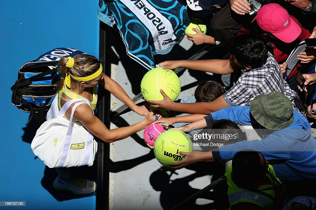 Maria Kirilenko of Russia signs autographs after winning her third round match against Yanina Wickmayer of Belarus during day six of the 2013 Australian Open at Melbourne Park on January 19, 2013 in Melbourne, Australia.
