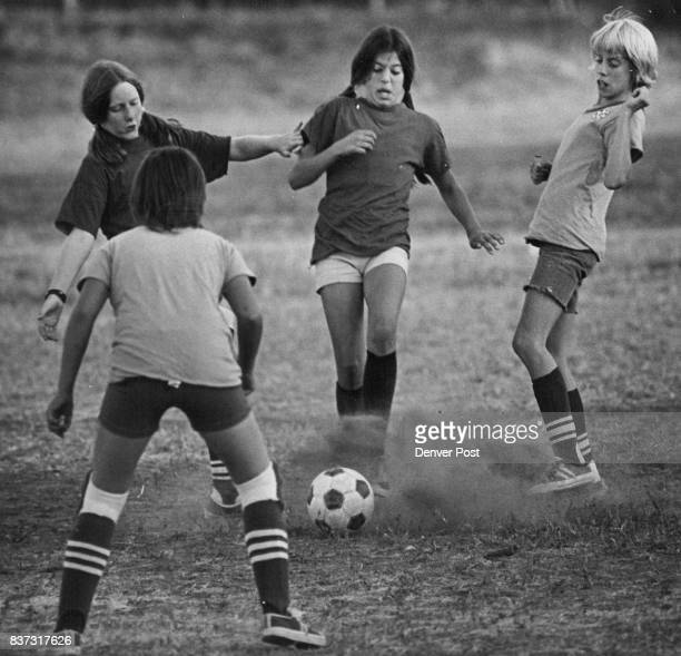 Maria Kirstopeit center Kicks at soccer ball in race with Deidra Middents left Laura Branca right and Theresa Kabala back to camera Credit Denver...