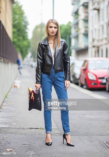 Maria Kolosova wears Tiziana Man Carella jacket Prada bag and American Apparel denim during Milan Fashion Week Spring/Summer 16 on September 27 2015...